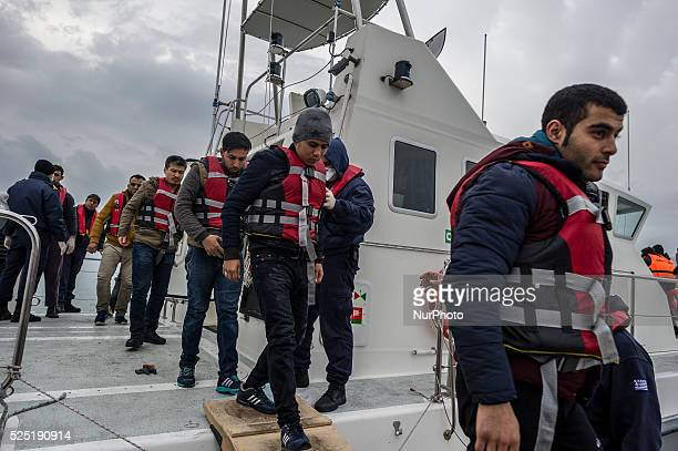 Migrants and refugees arrive on the Greek island of Lesbos while crossing the Aegean Sea from Turkey on March 2 in Mytilene The EU on March 2...