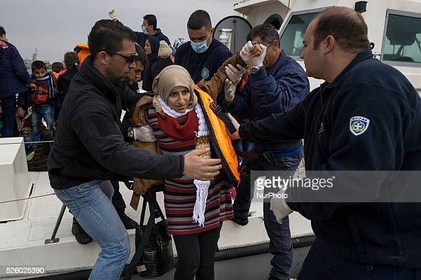 Migrants and refugees arrive on the Greek island of Lesbos while crossing the Aegean Sea from Turkey on March 2 in Mytilene. The EU on March 2...