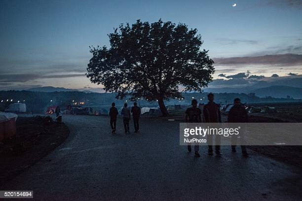Migrants and refugees at makeshift camp in the northern border village of Idomeni Greece on April 9 2016 Four migrant women and a child drowned on...