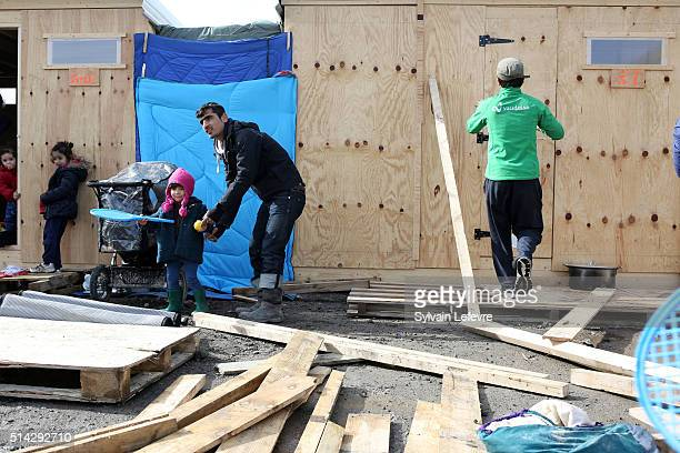 Migrants and refugees build shelters in the first internationalstandard refugees camp build by 'Medecins Sans Frontiere' organisation on March 8 2016...