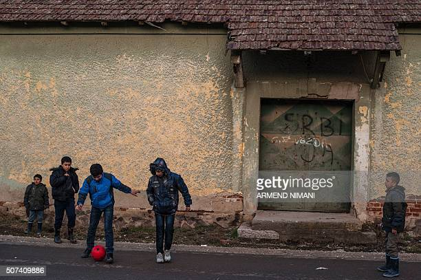 Migrants and refugees children play with a football as they wait for a train after crossing the Macedonian border into Serbia near the town of...