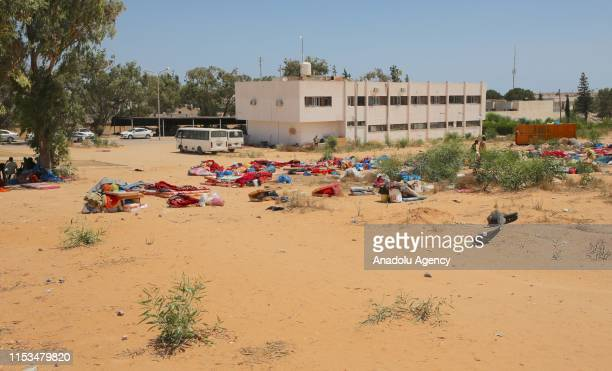 Migrants and refugees continue to wait after a migrant shelter targeted by Haftars forces in Tripoli, Libya on July 03, 2019. Libyas UN-recognized...