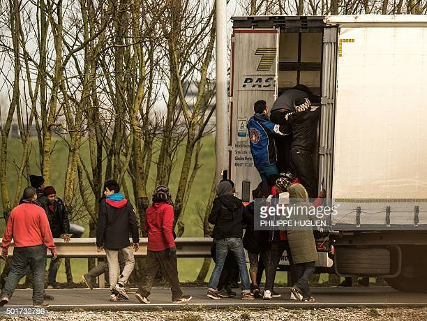 Migrants and refugees enter the trailer of a truck on December 17 2015 on the site of the Eurotunnel in Calais A growing number of migrants seeking...