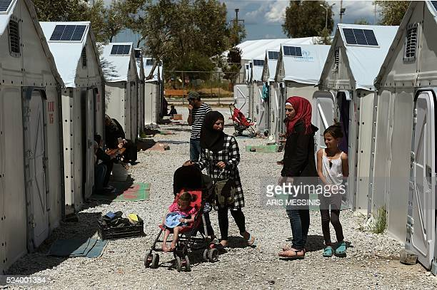 Migrants and refugees go about with their daily life during Queen Rania of Jordan visit at the refugee site of Kara Tepe in Mytilene on April 25 2016...