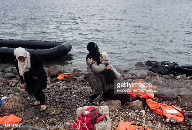 Migrants and refugees land on the beach at Sykamia west of the port of Mytilene on the Greek island of Lesbos after crossing the Aegean sea from...