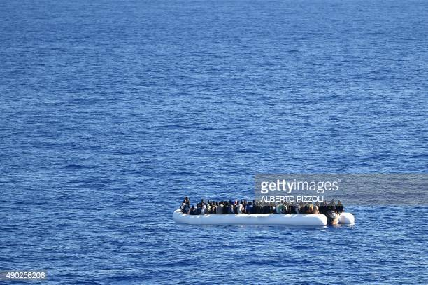 Migrants and refugees, mainly from Nigeria, Ghana, Senegal and Sierra Leone, wait to be rescued at sea and transported to the German navy frigate...