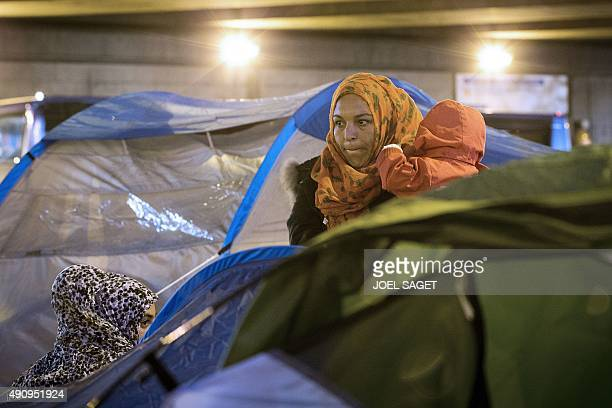 Migrants and refugees mainly from Syrian prepare to leave their make shift camp after being evicted by the French authorities from the camp setup at...