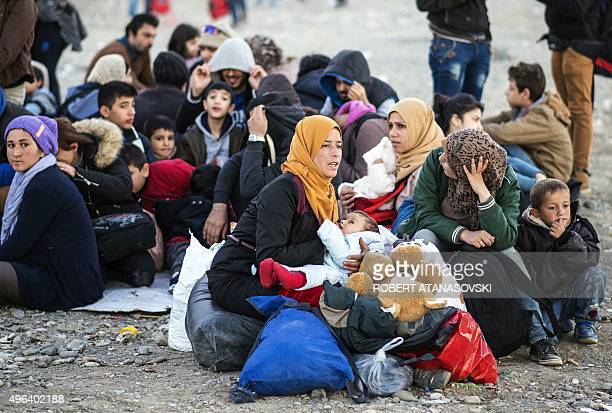 Migrants and refugees prepare to enter a registration camp after crossing the GreeceMacedonia border near Gevgelija on November 9 2015 The flow of...