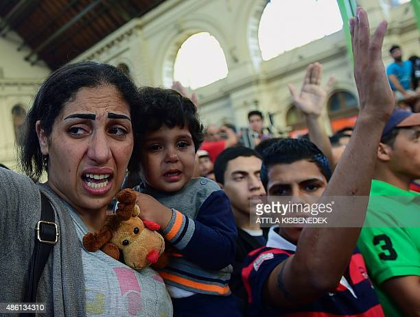 Migrants and refugees protest at the Keleti railway station in Budapest on September 1 2015 Keleti the biggest Hungarian railway station was closed...