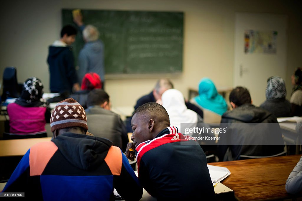 Migrants and refugees seeking asylum in Germany attend a German-language class at the shelter where they live while their asylum applications are processed on February 25, 2016 in Sarstedt, Germany. Germany received approximately 1.1 million newcomers in 2015 and is now facing the arduous task of processing asylum claims and taking steps to integrate those whose applications are accepted.