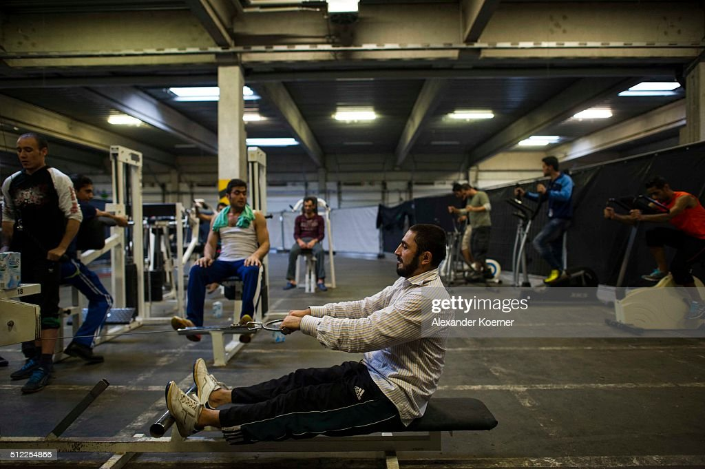 Migrants and refugees seeking asylum in Germany attend a sport class at the shelter where they live while their asylum applications are processed on November 17, 2015 in Sarstedt, Germany. Germany received approximately 1.1 million newcomers in 2015 and is now facing the arduous task of processing asylum claims and taking steps to integrate those whose applications are accepted.