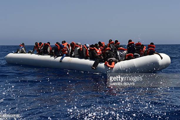 Migrants and refugees wait for help during a rescue operation at sea of the Aquarius a former North Atlantic fisheries protection ship now used by...