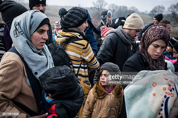 Migrants and refugees wait for security check after crossing the Macedonian border into Serbia, near the village of Miratovac, on January 29, 2016....