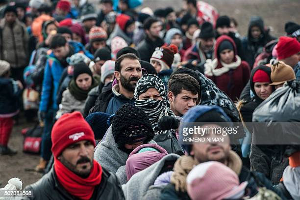 Migrants and refugees wait for security check after crossing the Macedonian border into Serbia near the village of Miratovac on January 29 2016 More...