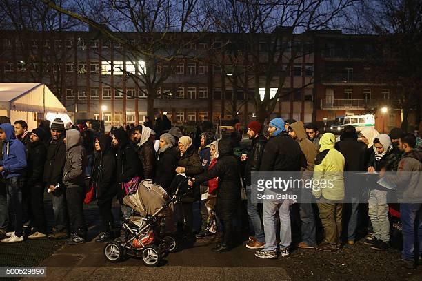 Migrants and refugees wait in the early hours outside the Central Registration Office for Asylum Seekers of the State Office for Health and Social...