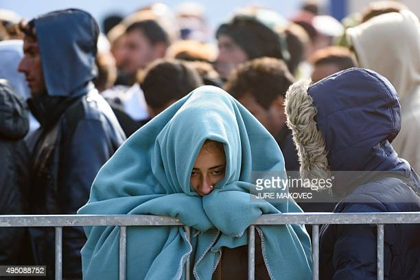 Migrants and refugees wait to cross the SlovenianAustrian border on October 31 2015 in Sentilj Austria's interior minister on October 29 reiterated...