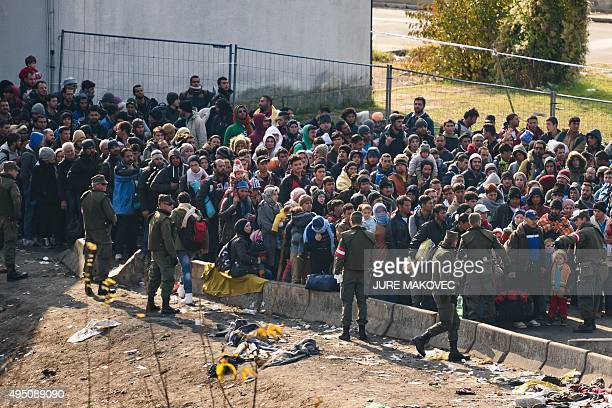 Migrants and refugees wait to cross the Slovenian-Austrian border on October 31, 2015 in Sentilj. Austria's interior minister on October 29...