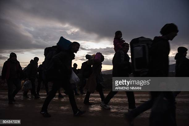 Migrants and refugees walk after crossing the Macedonian border into Serbia near the village of Miratovac on January 10 2016 More than a million...