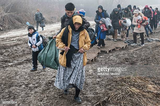 Migrants and refugees walk after crossing the Macedonian border into Serbia, near the village of Miratovac, on January 29, 2016. More than one...