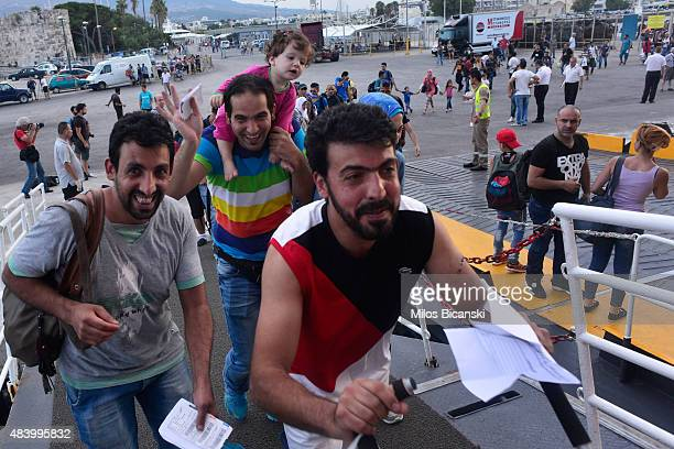 Migrants and refugees with temporary documents board a ferry to take them to Athens at the port of the Greek island of Kos on August 14 in Kos Greece...