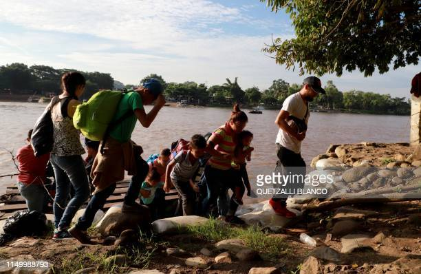 Migrants and residents use a makeshift raft to illegally cross the Suchiate river from Tecun Uman in Guatemala to Ciudad Hidalgo Chiapas state Mexico...