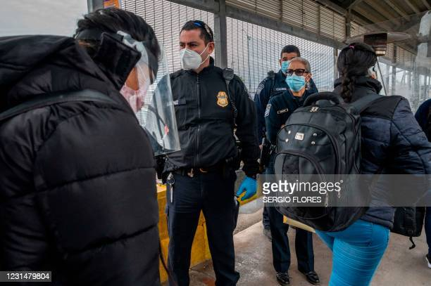 Migrants approach the American border on Gateway International Bridge in Brownsville, Texas on March 2, 2021. - President Biden announced that he was...