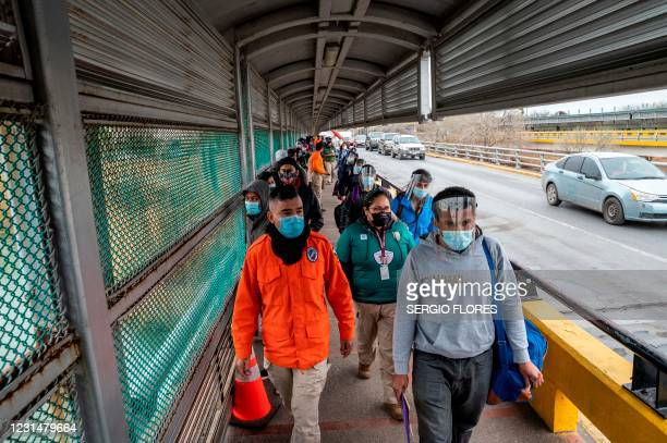 Migrants approach the US border on Gateway International Bridge in Brownsville, Texas on March 2, 2021. - President Biden announced that he was...