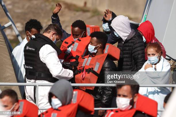 Migrants are brought into Dover docks by Border Force staff on September 9, 2021 in Dover, England. Facing a continued rise in migrant arrivals...