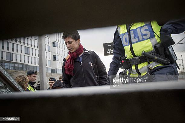 Migrants are checked by the police at Hyllie train station in Malmoe Sweden on November 12 2015 The Swedish government on November 11 2015 said it...