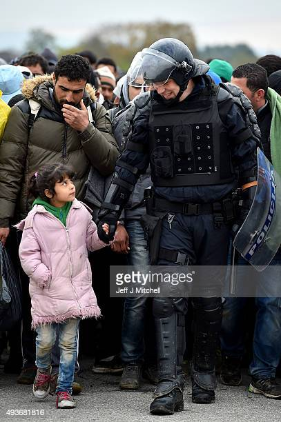Migrants are escorted by police through Dobova as they are walked holding camp on October 22 2015 in Dobova Slovenia Thousands of migrants marched...