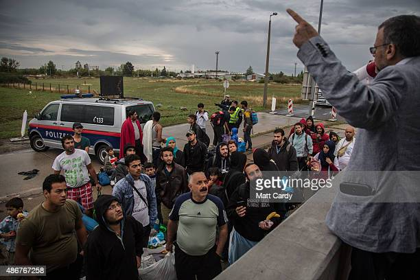 Migrants are given instructions in arabic cross the border from Hungary into Austria on September 5 2015 near Nickelsdorf Austria Last night the...