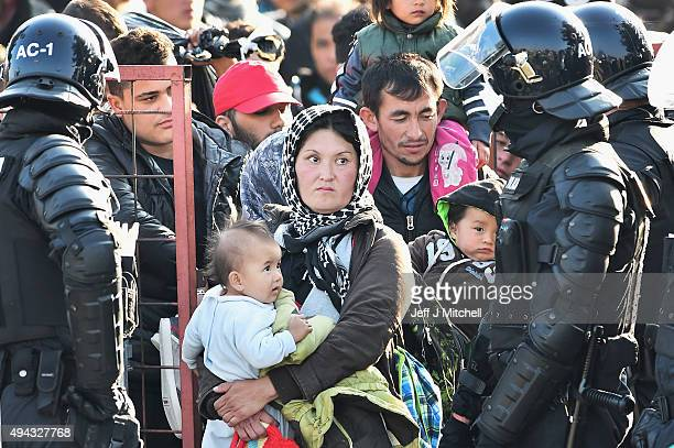 Migrants are held at a holding camp in the village of Dobova before boarding a train heading towards Austria on October 26 2015 in Dobava Slovenia...