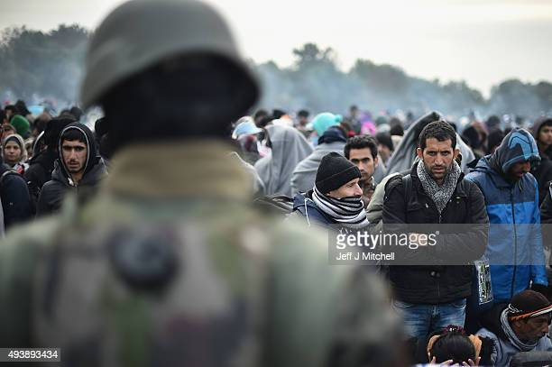 Migrants are held at the village of Rigonce, after crossing over from Croatia on October 23, 2015 in Rigonce, Slovenia. Thousands of migrants marched...