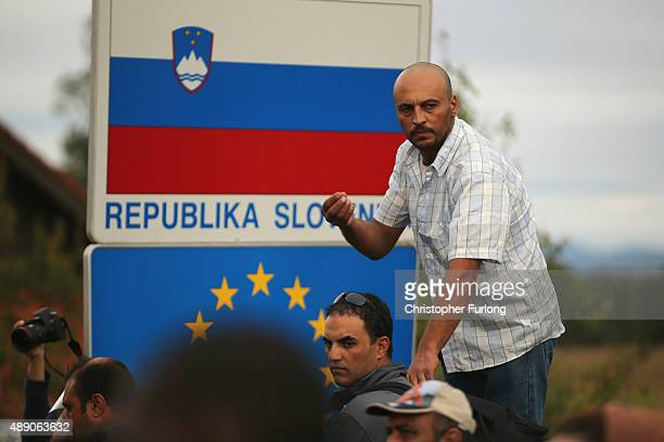 Migrants are held back by Slovenian riot police at the border in the small Croatian village of Harmica on September 19, 2015 in Harmica, Croatia....