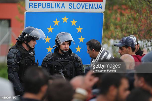 Migrants are held back by Slovenian riot police in the small Croatian village of Harmica on September 19, 2015 in Harmica, Croatia. Last night police...