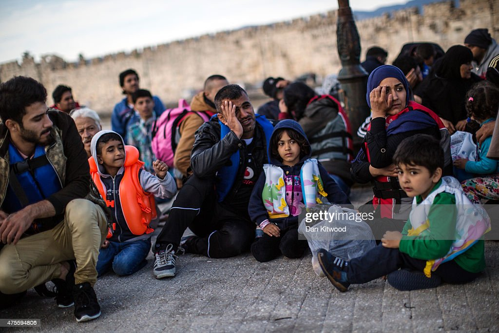 Migrants are lined up on the dock after being picked up in a dinghy offshore making their way from Turkey on June 02, 2015 in Kos, Greece. Migrants are continuing to arrive on the Greek Island of Kos from Turkey who's shoreline lies approximately 5 Km away. Around 30,000 migrants have entered Greece so far in 2015, with the country calling for more help from its European Union counterparts.
