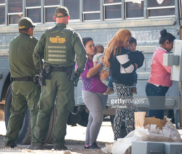 Migrants are loaded onto a bus by U.S. Border Patrol agents after being detained when they crossed into the United States from Mexico on June 01,...