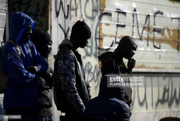 Migrants are pictured in a squatted abandoned penicillin factory on November 14 2018 in Rome's Tiburtina district where hundreds of migrants live in...