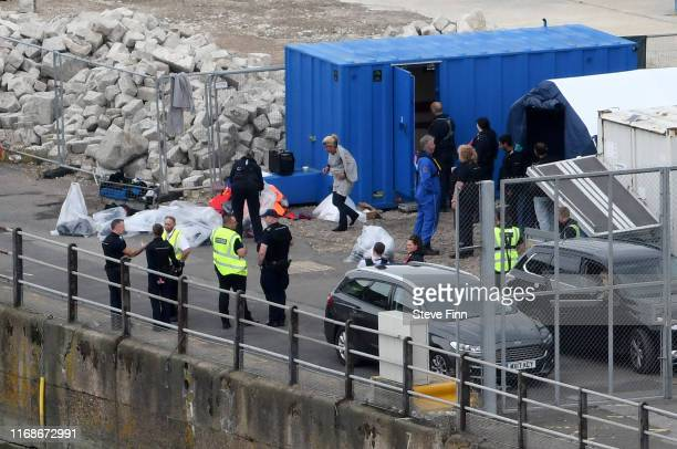 Migrants are processed at the Port of Dover on September 10 2019 in Dover England A record number of Migrants from at least eight different countries...