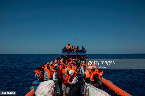 Migrants are rescued by members of the Aquarius rescue ship run by nongovernmental organisations SOS Mediterranee and Medecins Sans Frontieres in the...