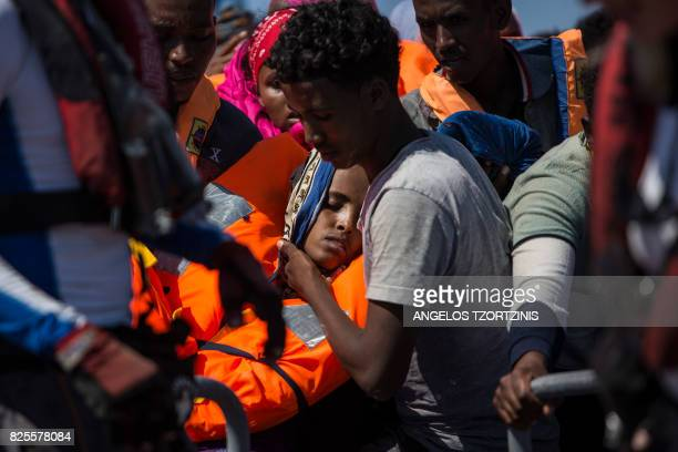 TOPSHOT Migrants are rescued by the Aquarius rescue ship run by nongovernmental organisations SOS Mediterranee and Medecins Sans Frontieres in the...