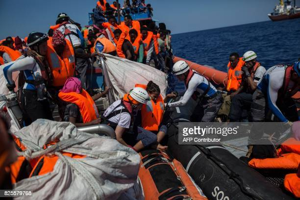 Migrants are rescued by the Aquarius rescue ship run by nongovernmental organisations 'SOS Mediterranee' and 'Medecins Sans Frontieres' in the...