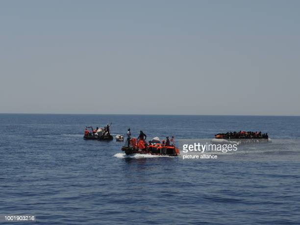 Migrants are saved from a precarious rubber dinghy by Doctors without borders and SOSMediterranee in the Mediterranean sea 27 July 2017 Photo Lena...