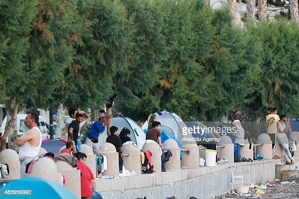 Migrants are seen after crossing part of the Aegean sea from Turkey to Greece in Kos Island on August 13 2015