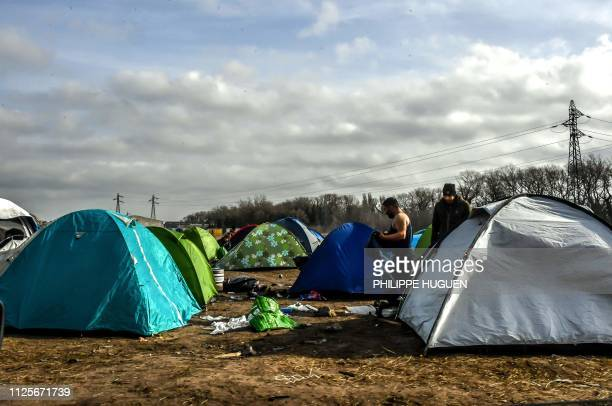 Migrants are seen at their make shift camp in the vicinity of the former 'Jungle' camp site, near the northern French port city of Calais on February...