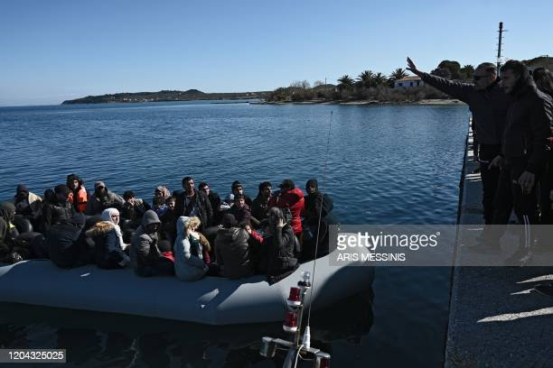 Migrants are seen on an inflatable boat as local residents prevent them from disembarking in Lesbos island on March 1 2020 Greece said Sunday it has...