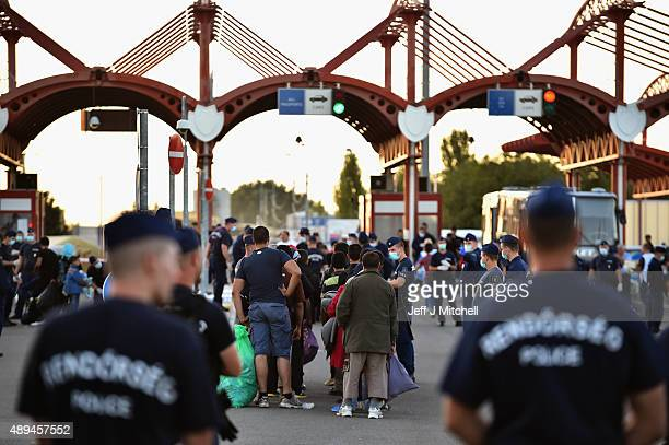 Migrants arrive at a border point between Croatia and Hungary where they will be transported by bus through to Austria on September 21 2105 in...