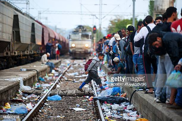 Migrants arrive at a Macedonian railway station in Gevgelija on August 22 2015 More than 1500 mostly Syrian refugees trapped in a noman's land for...