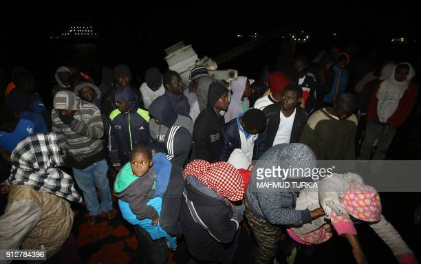 Migrants arrive at a naval base in Tripoli late on January 31 after they were rescued off Lybia's coast About 240 illegal migrants from Arab and...