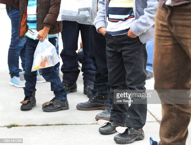 Migrants arrive at an Annunciation House facility to be cared for after being released by the US Immigration and Customs Enforcement on January 14...